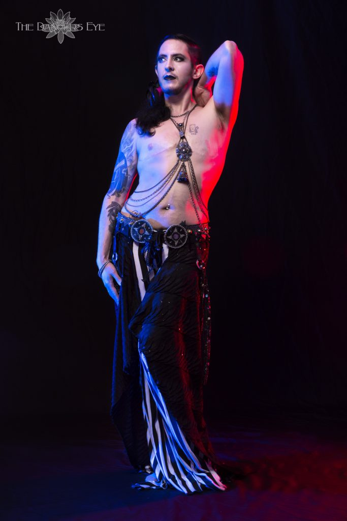 Male Belly Dancer Kamrah in goth costuming
